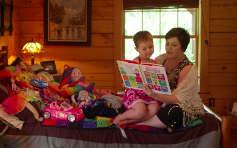 """This is from HBO's """"Transhood"""" documentary. A mother puts her 4 year old son in a dress and reads him LGBT propaganda. You're literally watching her brainwash the child into thinking he's a girl. It's no mystery how children end up """"trans."""" This is it. Right here. #BoycottHBO https://t.co/WCVb0BpkYi"""