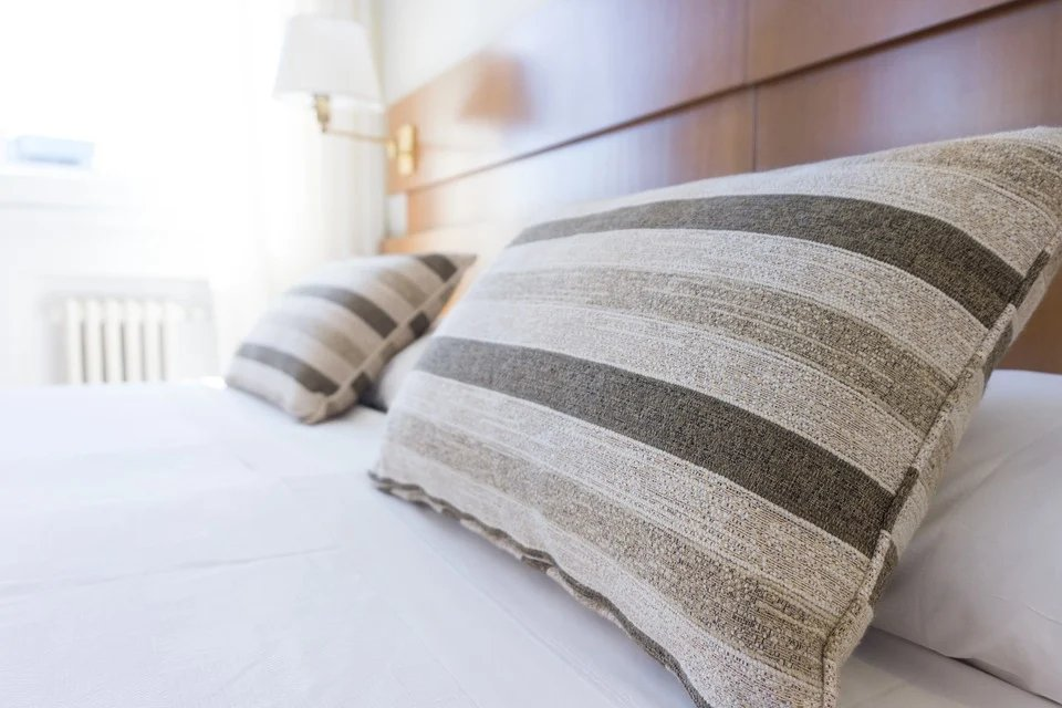 Use nice bedding to make your bedroom more appealing to #homebuyers. #buyingtips