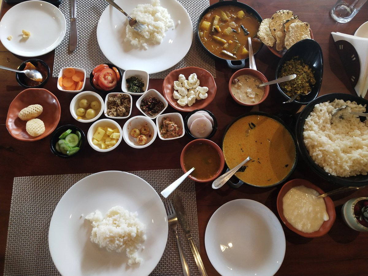 An elaborate Kerala meal. Trust me each and everything was flavoursome. And I was amazed with rice this thick, yet so light. I am not a fan of rice but this was too good. #Throwback #Wayanad