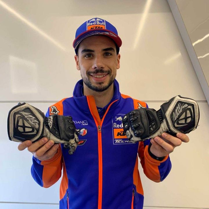 Own a signed pair of @_moliveira88 racing gloves!  The @Tech3Racing rider ended the 2020 season in some style yesterday, dominating his home #PortugueseGP🇵🇹 from start to finish.  Own a piece of racing history ➡️   #MO88 #MotoGP #twowheelsforlife