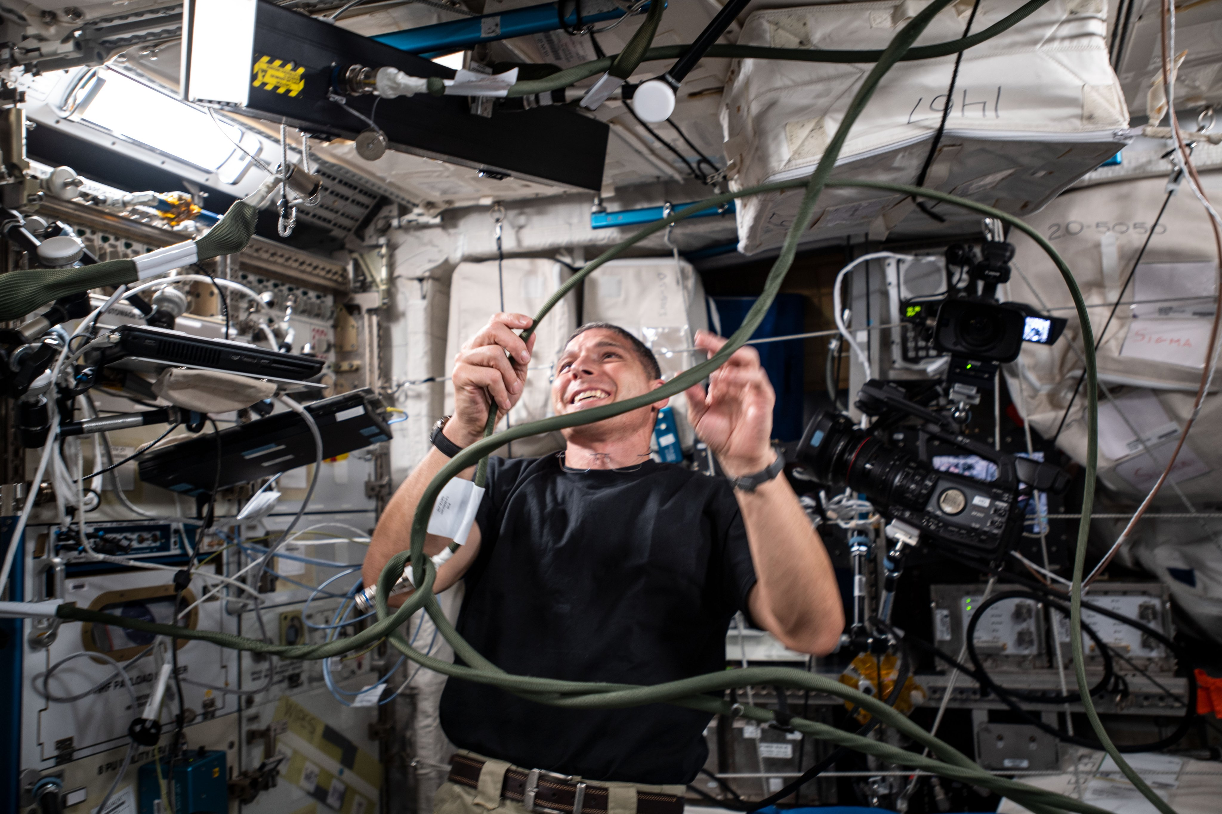 SpaceX Crew-1 Commander and Expedition 64 Flight Engineer Michael Hopkins of NASA sets up hardware for the Grip study that is researching how an astronaut's dexterous manipulation is affected by microgravity.