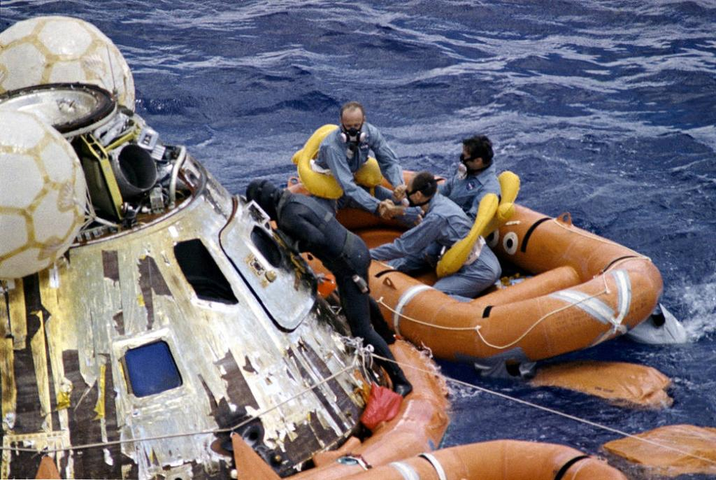 #Apollo12 splashed down near American Samoa #OTD 51 years ago. This image features a U.S. Navy Underwater Demolition Team swimmer assisting astronauts Pete Conrad, Dick Gordon, and Al Bean during recovery operations in the Pacific Ocean. https://t.co/Nj0Fw8Bre3