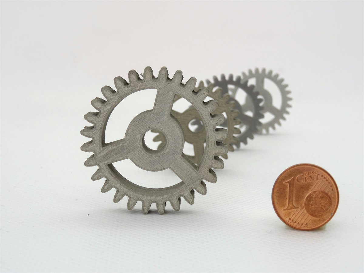 These spur gears – seen here with a euro cent coin for scale – have been produced in stainless steel to space quality using only a desktop 3D printer, by ESA-supported startup TIWARI at @ESABICDarmstadt. #3Dprinting #ESATech image of the week