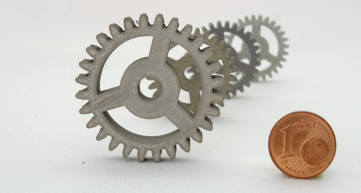 These spur gears – seen here with a euro cent coin for scale – have been produced in stainless steel to #space quality standards using only a desktop #3D printer, by ESA-supported startup TIWARI at @ESABICDarmstadt 👉