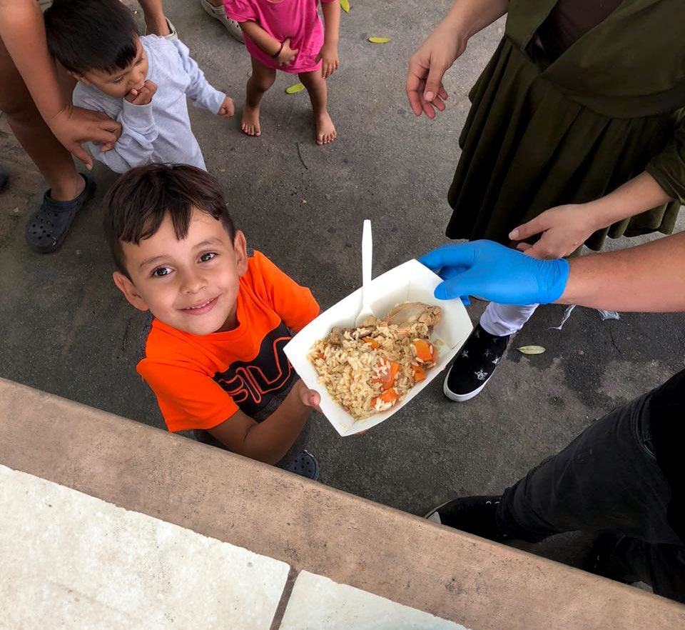 At the Instituto Jose Trinidad Reyes post-hurricane shelter in San Pedro Sula, Honduras — smiles like this are why the @WCKitchen team wakes up every day! A warm plate of food nourishes not just the body, but also the soul. #ChefsForCentralAmerica