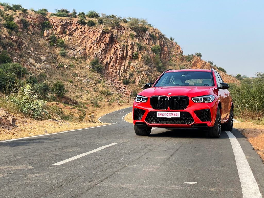 Toronto Red Metallic. It's more orange. Love it. #BTS on my shoot with the powerful new M model in India. SVP #X5M #sexybeast 2/x