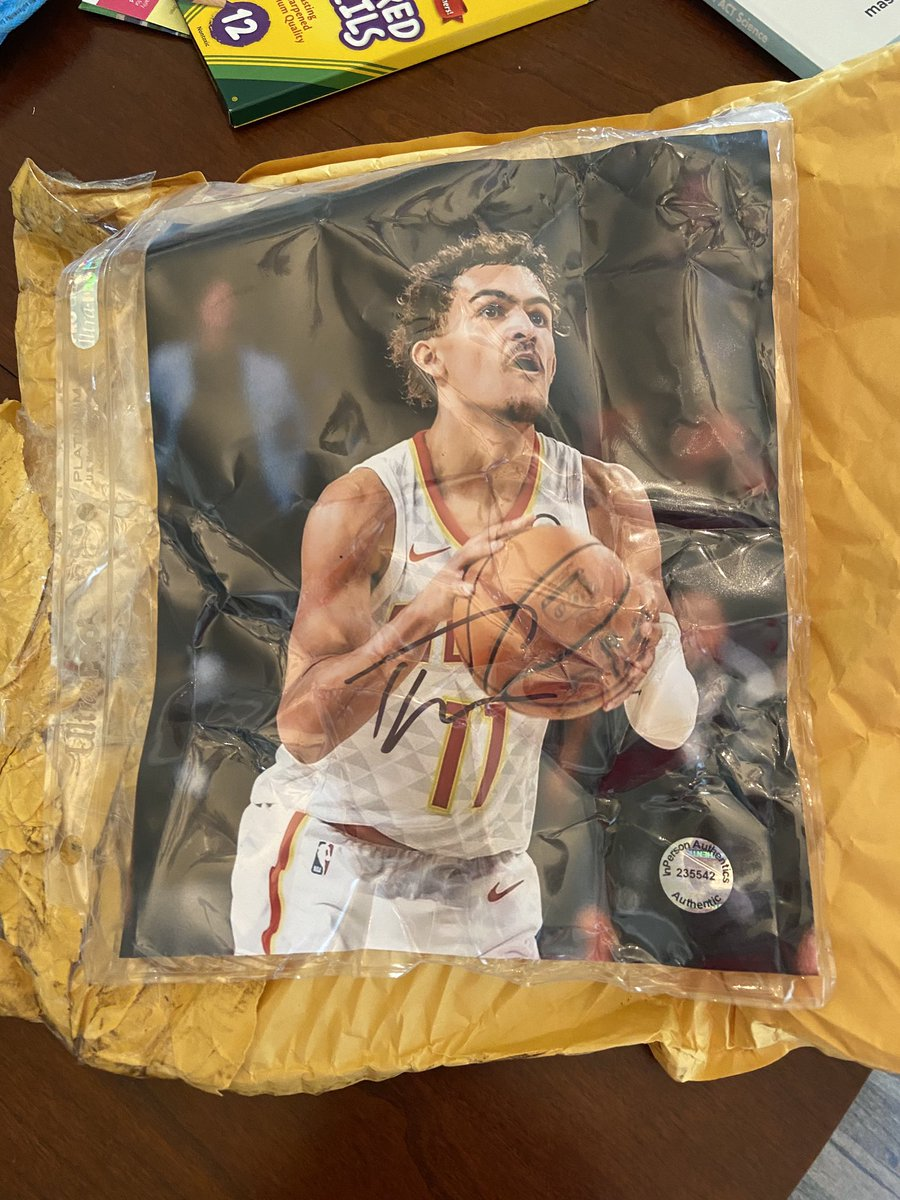 #BetterThanSanta #PostmatesContest signed Trae Young Jersey - my signed photo was ruined in the mail 😭- who uses bubble wrap instead of cardboard 🤦♀️