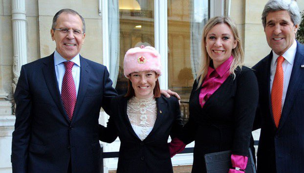 Here's Jen Psaki hugging Russia's Foreign Minister and Russia's chief foreign affairs propagandist while wearing a pink hammer and sickle hat https://t.co/WMJytaxd7J