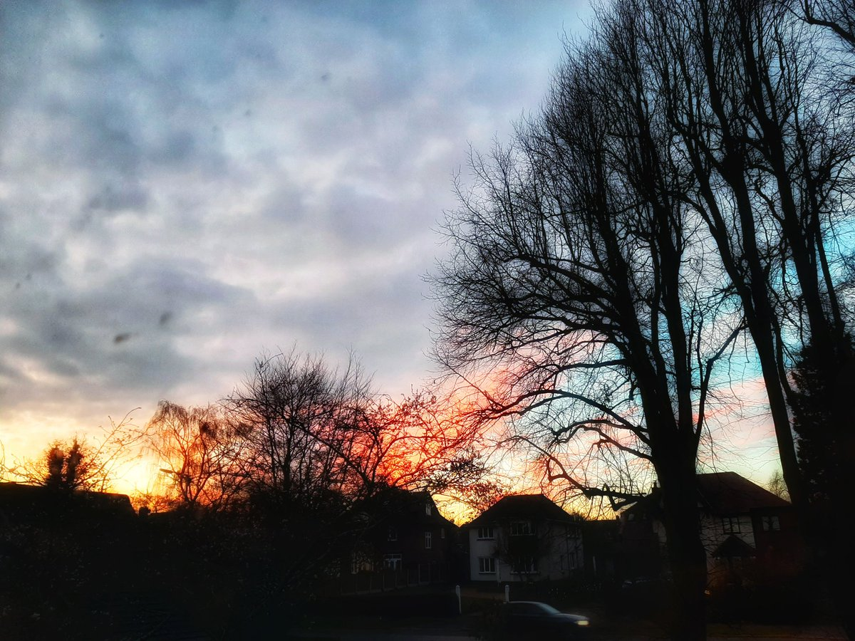 Photo of a spectacular sunset sky from my window.  And yes, I will be firing the window cleaner*  *the window cleaner is me; those smudges are on the inside  #MondayMotivation #Sunset #Sky