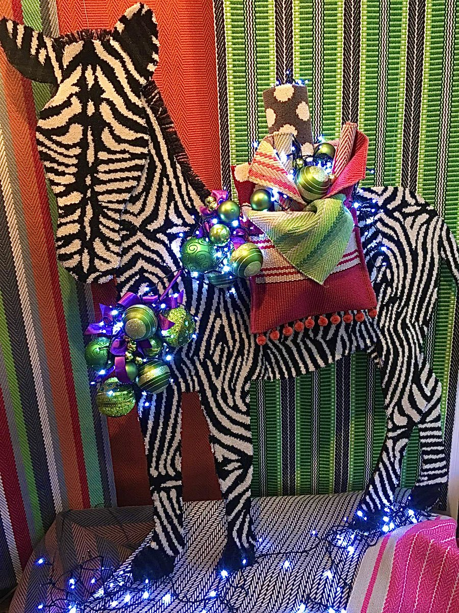 """Our window display for #Christmas is the start of something new & bright🙏 Mr Zebra welcome to Hertford Flooring - you are such a pretty sight...🤩"" Window Display By Susannah Design  @Roger_OatesUK @AlternativeFlr  #zebra #christmaswindow #December1st #Wow #LightTheWorld 🧡💫"