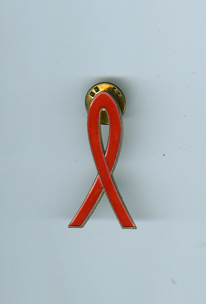 Today is #WorldAIDSDay - a day to show support for those living with HIV/AIDS, to remember those who have died, and to demand an end to AIDS and its stigma.   The red ribbon has been worn since the early 1990s, and this one from our collection dates right back to c.1991 (1/3)