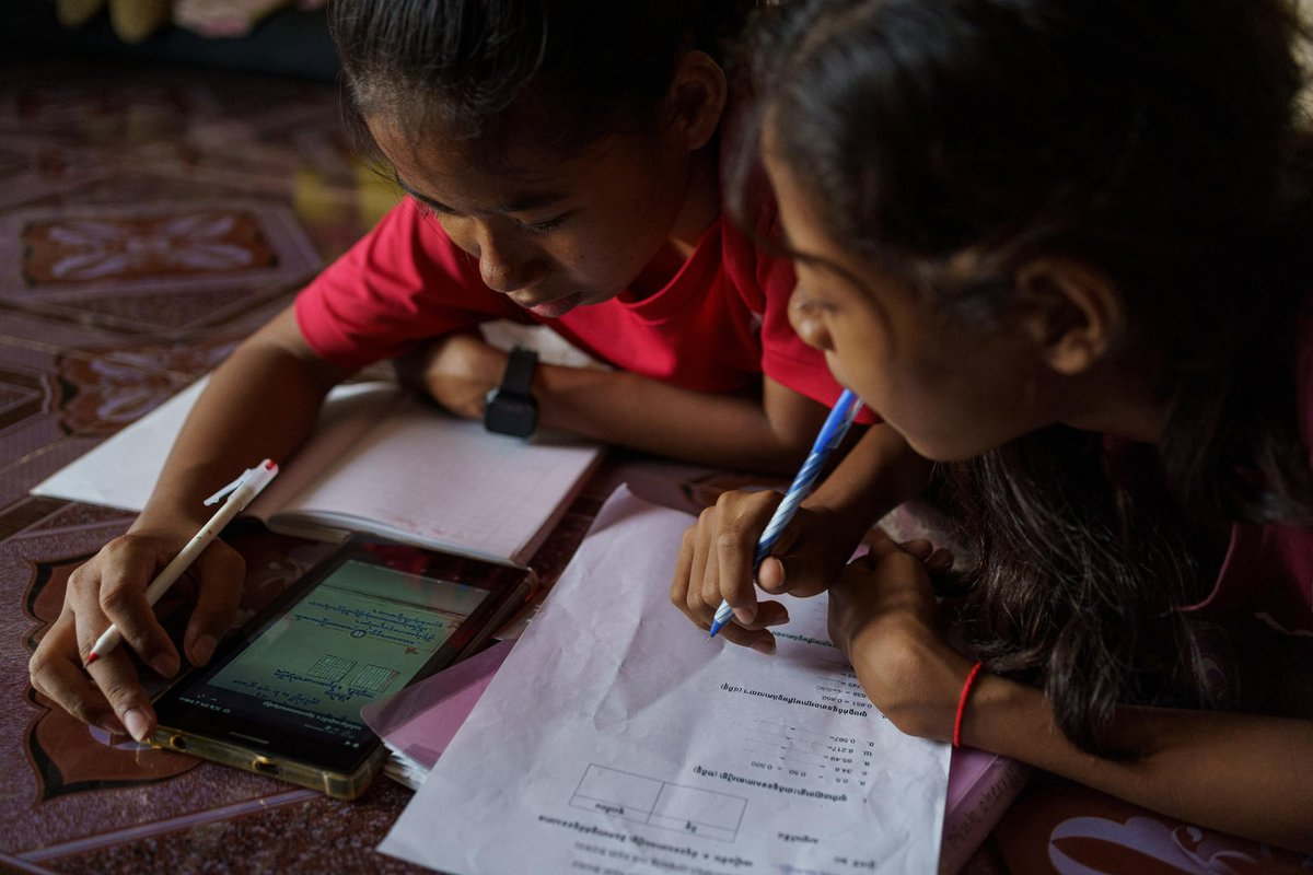 Nah Nah helps her sister with her homework.  During #covid19 closures, their school in Cambodia has been loaning tablets to those in need and  supporting families struggling to afford internet.  We must bridge the digital divide to ensure quality education for #GenerationCovid