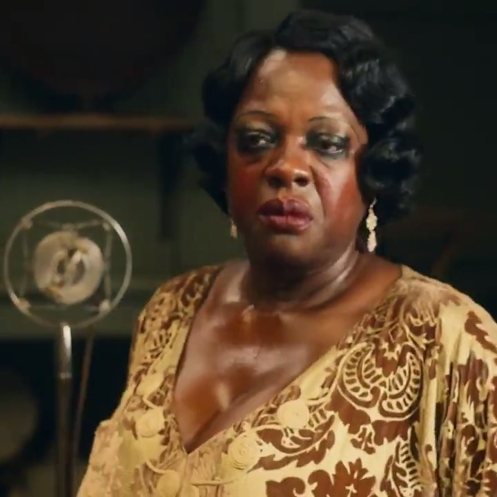 """EXCLUSIVE FIRST LOOK: Viola Davis as Ma Rainey in Ma Rainey's Black Bottom. Viola completely embodies the aptly named """"Mother of the Blues"""" in this scene.   Ma Rainey's Black Bottom will premiere December 18 globally on Netflix."""