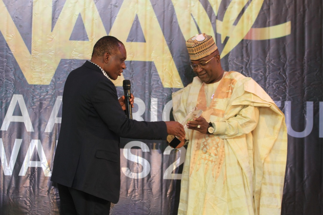 NIGERIA AGRICULTURE AWARDS (NAA) 2020  Dr Nasiru Gawuna @DGawuna, the Deputy Gov. of Kano State, who also doubles as the State's Commissioner for Agric, clinches the COMMISSIONER OF THE YEAR AWARD!!  Prof. E. Ikani presents his award to his rep.   #NAA2020 #RewardingExcellence