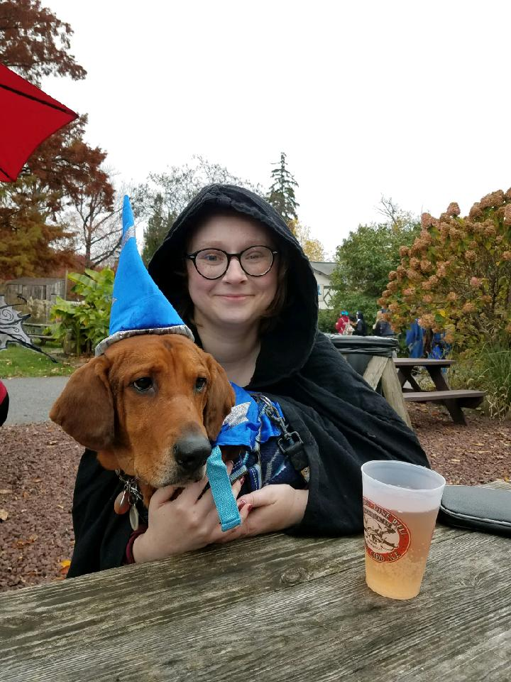 happy #VisibleNonbinary day ! i dont have much to offer in terms of entertainment but please look at my dog at the renn faire (he is the sorcerer of slobber)