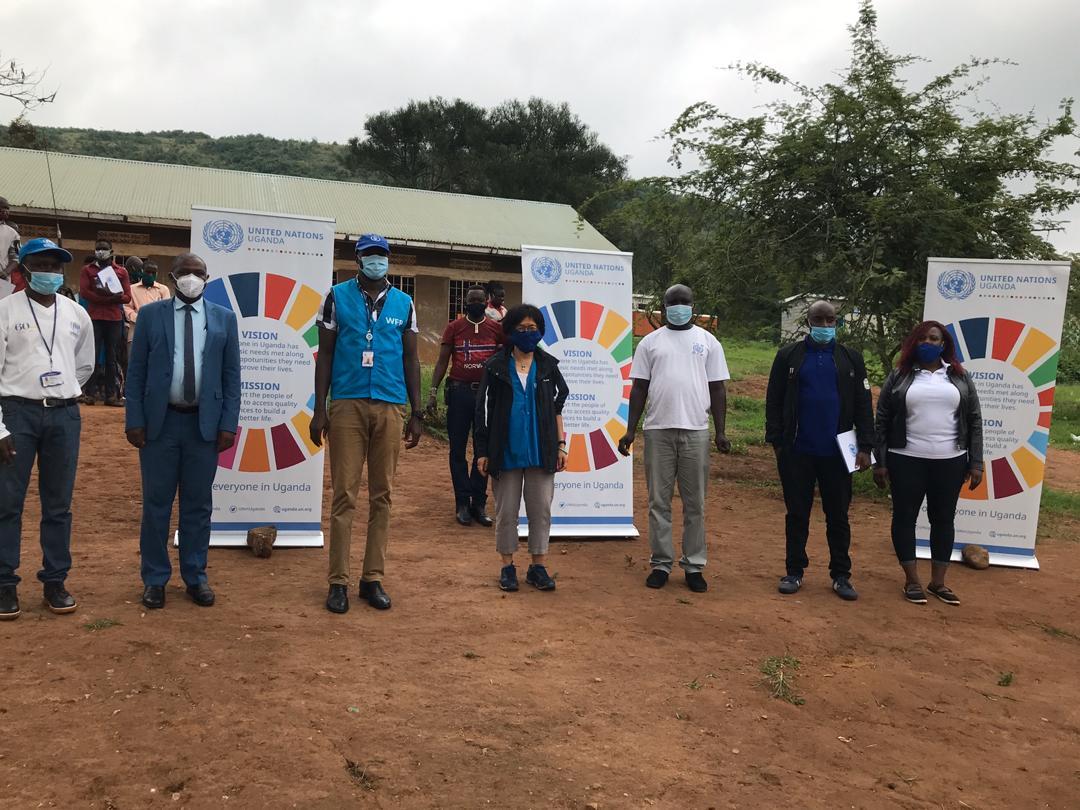 Staff from @UNHCRuganda @WFP @IOM_Uganda with district local government officials during the commemoration of #UN75 in South Western Uganda at Rubondo, Isingiro @UN_SDG @GCICUganda
