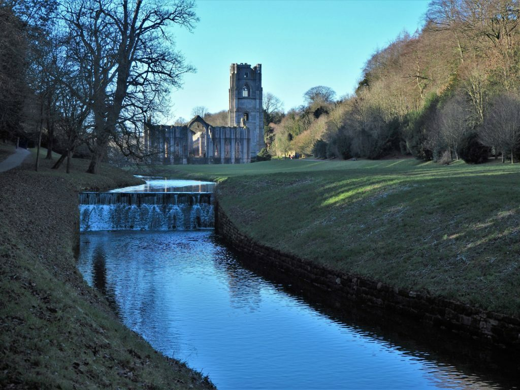 Fountains Abbey from a riverside path, North Yorkshire, England Read more at https://t.co/QX17DaKGCl #Yorkshire #Fountains Abbey #photography #tw https://t.co/3bs3SZsOux