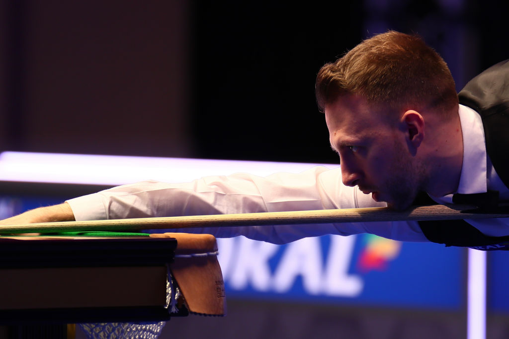 World number one Judd Trump held off Ricky Walden's fightback to reach the quarter-finals of the UK Championship.  More: