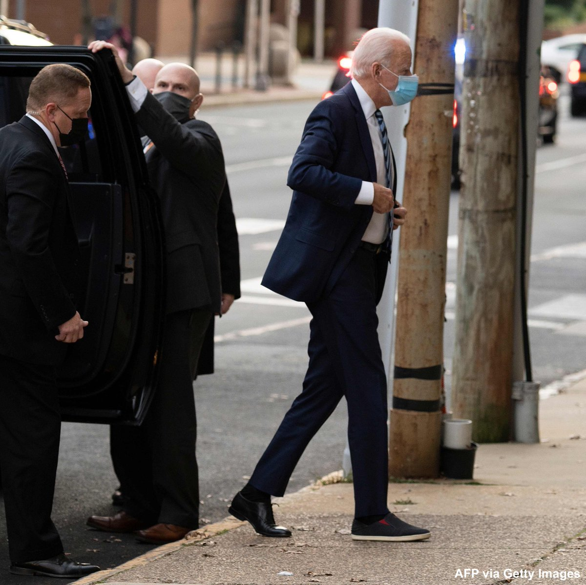 President-elect Joe Biden wears a slip-on shoe over his fractured foot as he arrives at The Queen in Wilmington, Delaware. Biden fractured his right foot in a fall last weekend while playing with his dog.