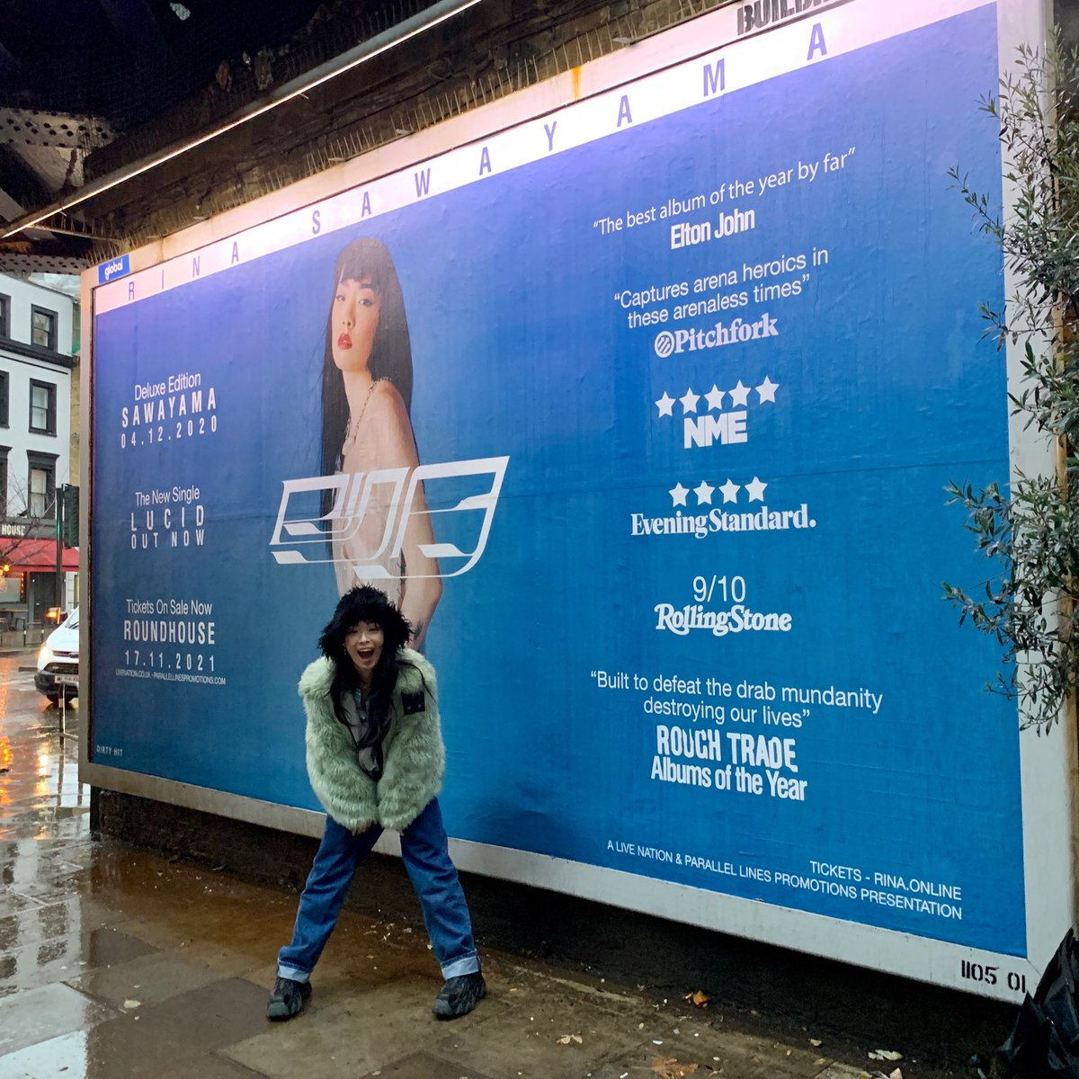 SO MANY THINGS HAPPENING TODAY 🥺  💥DELUXE SAWAYAMA IS OUT !!!   💥TICKETS FOR UK + IRELAND 2021 SHOWS ON SALE !!  💥LUCID video premiere tonight at 6pm GMT !  💥I stood in front of my first UK billboard in a characteristically rainy af day in Camden !!!!!