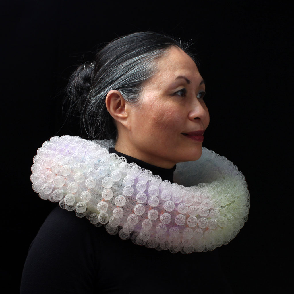 Artist Nora Fok combines jewelry design with textile art in her science and maths inspired wearable artworks, created by weaving, knitting, braiding, and knotting. #womensart