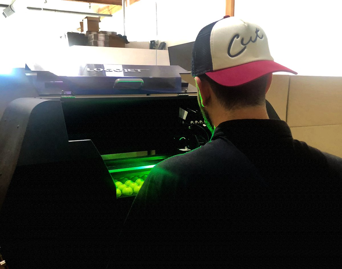 Our golf ball printer and part-time model Michael is rockin our new UNCLE NELLY trucker hat while we customize another order of balls. Pick up one of our four new hats and beanies before they sell out!