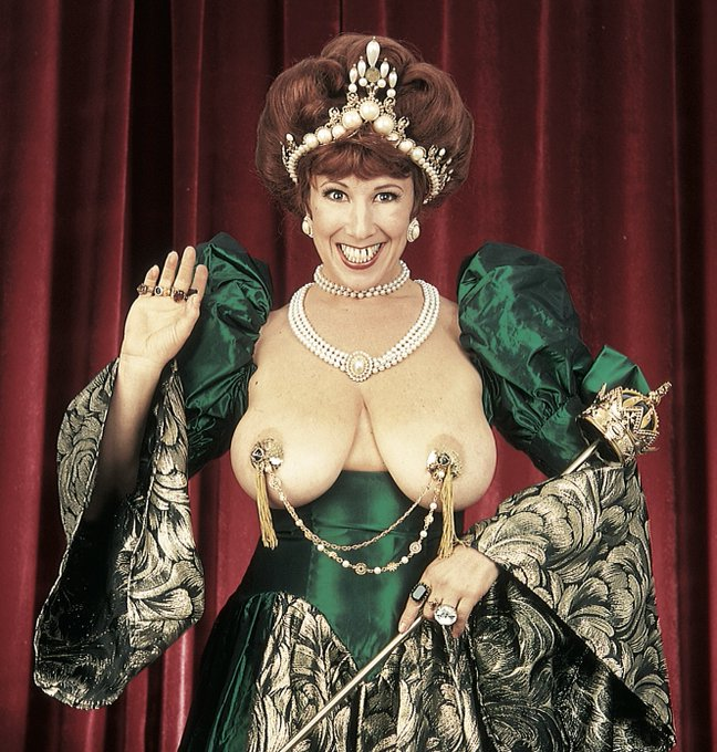 I'm posting this vintage topless photo... because I can. Behold the royal golden pasties! Rub them and