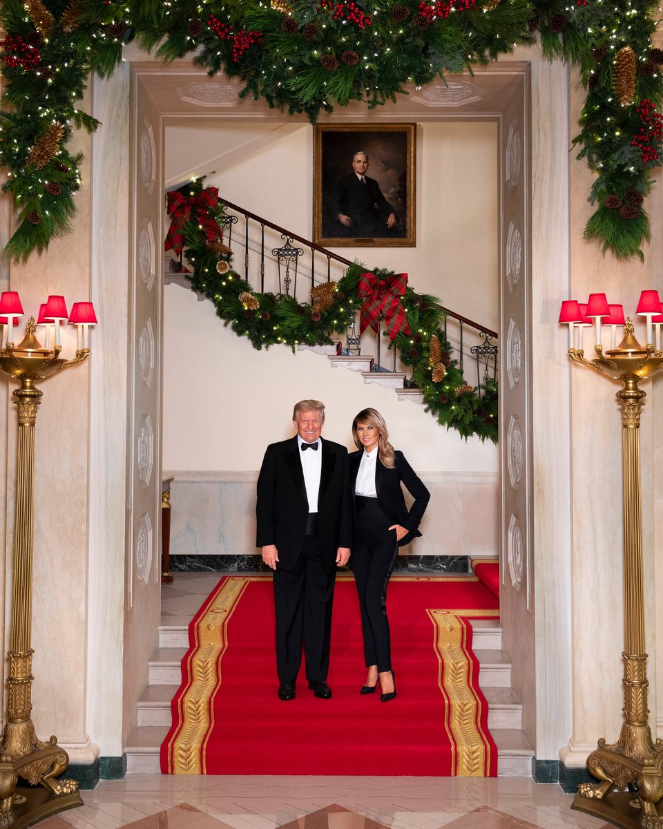 Merry Christmas from President Donald J. Trump and First Lady Melania Trump.  @realDonaldTrump & @FLOTUS are seen December 10, in their official 2020 Christmas portrait,on the Grand staircase of the White House in Washington, D.C. (Official White House Photo by Andrea Hanks)