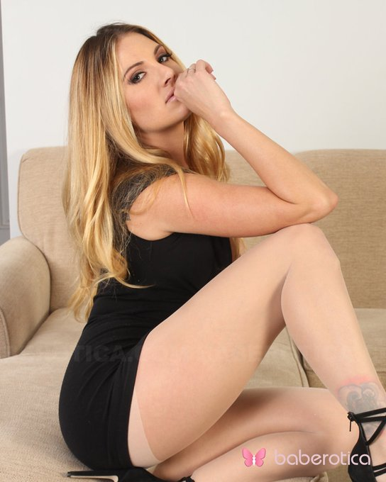 Blonde Teagan Presley has such a hot surprise for you! On an armchair, she spreads the legs and her pussy