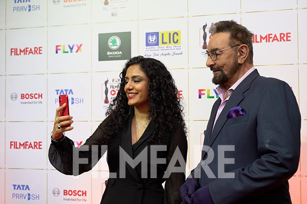 Replying to @filmfare: Caught candid at the red carpet were @iKabirBedi and @parveendusanj at #FlyxFilmfareOTTAwards.