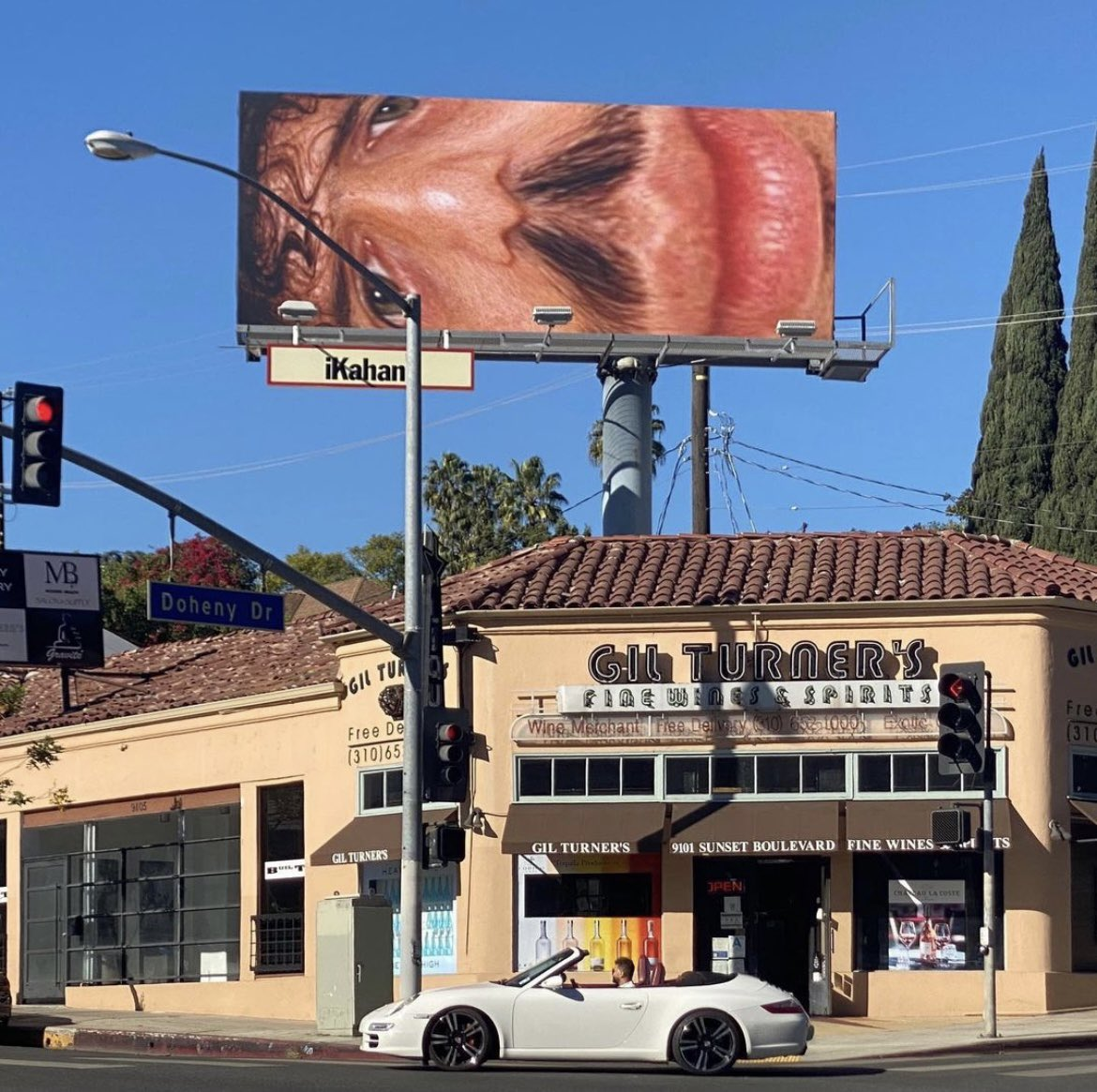 i got a new billboard on sunset for the holidays and somehow it got fucked up while they printed it and i look like an uglier stretched out version of my already ugly unstretched self