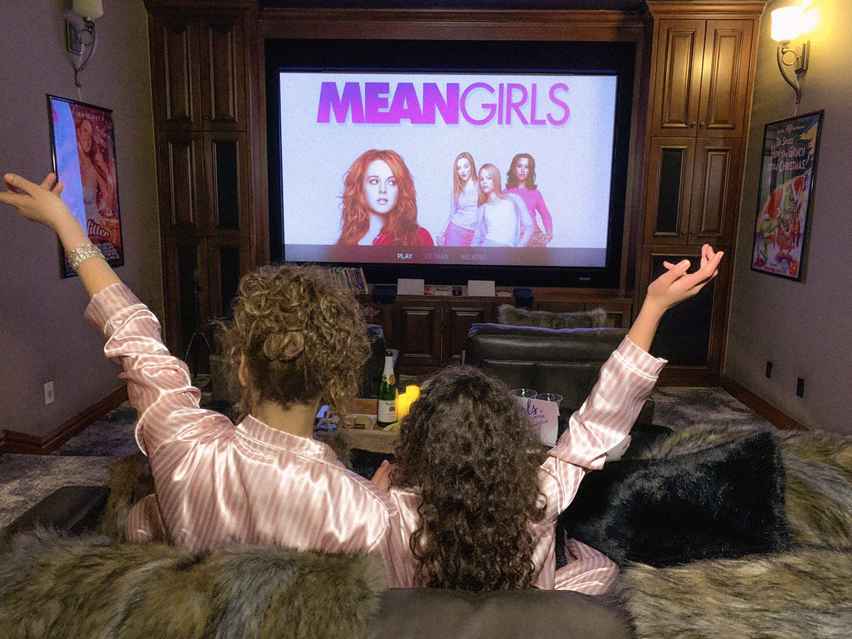First girls night of 2021! Sparkling apple cider, mangos, strawberries, cookies, and... Mean Girls, duh! 💅💅❤️❤️