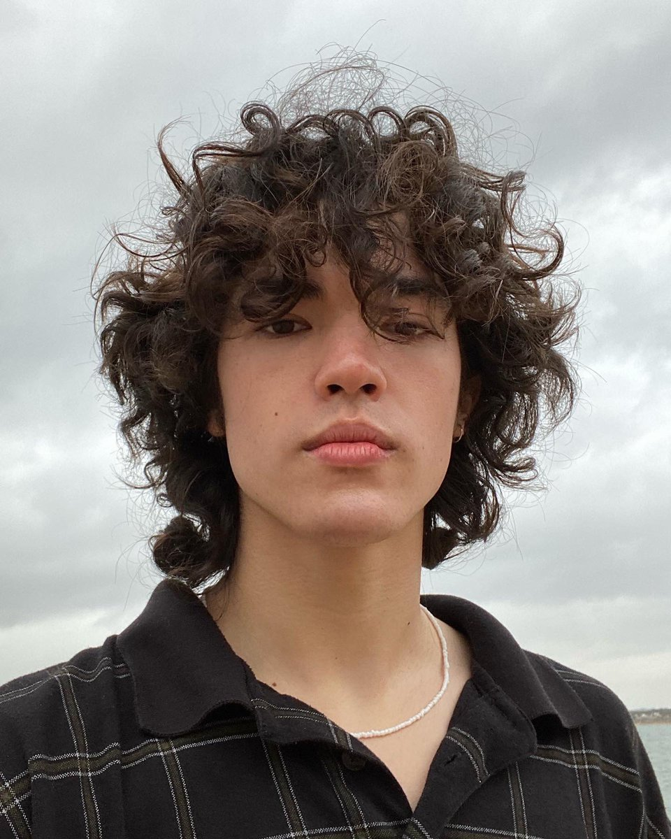 here comes the boy with the curls