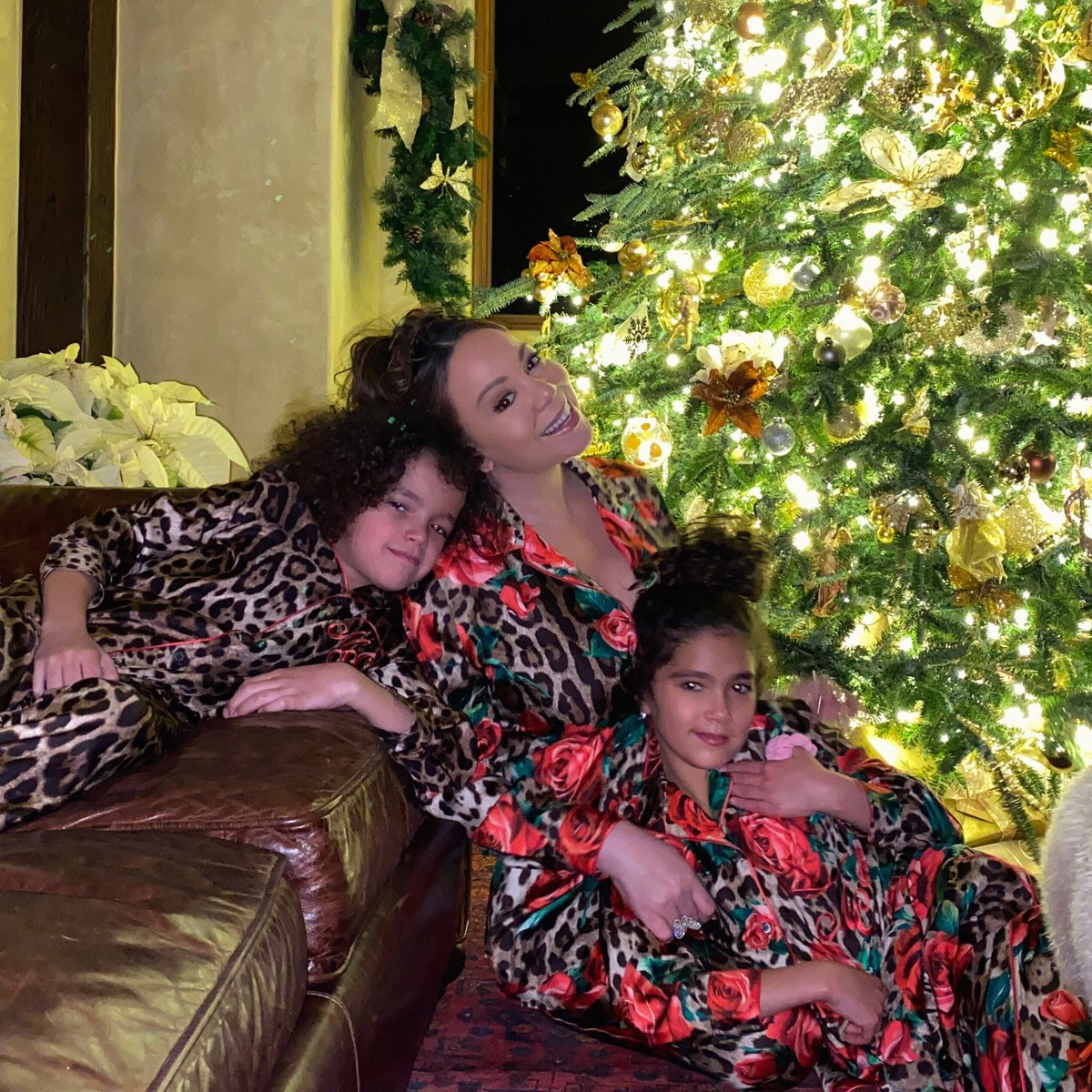 """Sitting w/ Dem Kids by the tree, getting ready to read """"A Snow Globe of Joy"""" from my memoir together ♥️😇🎄🌠 Thank you so much to everyone who supported #TheMeaningofMariahCarey My little girl self is grateful 😢 Love + appreciate you so much! Merry Christmas Eve to All! 🐑🎹❄️"""