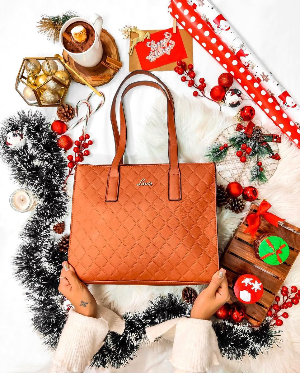 """""""Totally sleighed the Christmas look!"""" Comment 🎄 if Christmas cheer is in the air x Click this link to grab the featured satchel bag at 60% discount  x #stylishsatchel #sleekbag #stylishbag #satchelbag #christmasseason #christmasvibes #newyearready"""