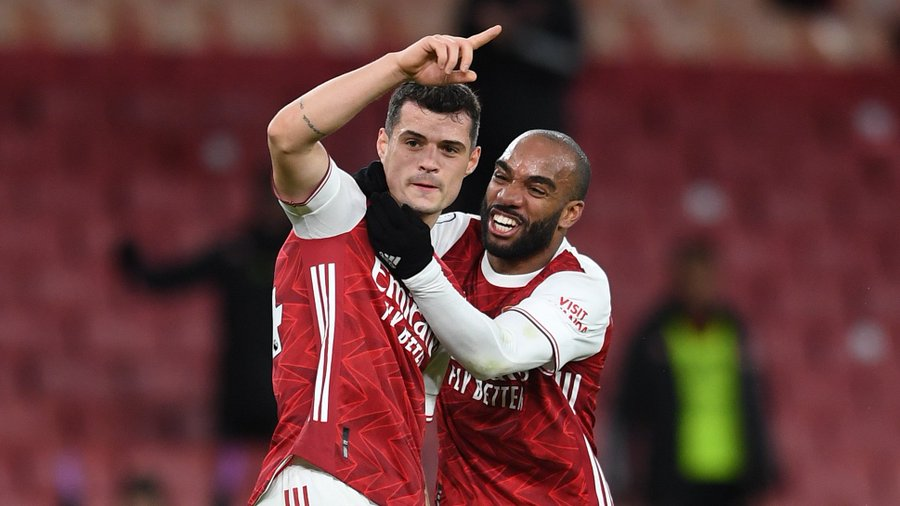 Granit Xhaka celebrates with Alex Lacazette after scoring against Chelsea at Emirates Stadium in the Premier League