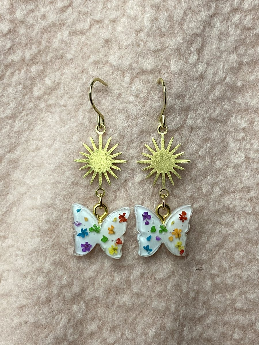 Hello all! I've been working hard on some new butterfly and tiny coffin earrings and I'm going to be updating my etsy this Wednesday the 30th at 8pm est!! There will be 19 new styles, each one of a kind :) here's what will be in it:   LGBT pride butterflies! 🏳️🌈