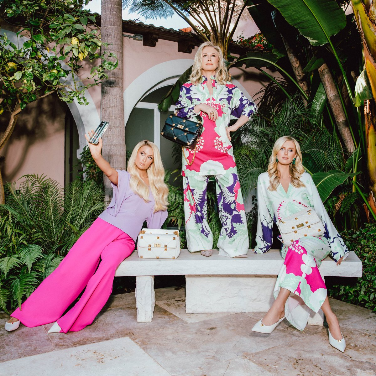 #kathyhilton, #parishilton and #nickyhilton in full Valentino looks at the , each carrying the new Valentino Garavani #RomanStud bag in a range of styles, from black and white nappa leather to a special knitted version.