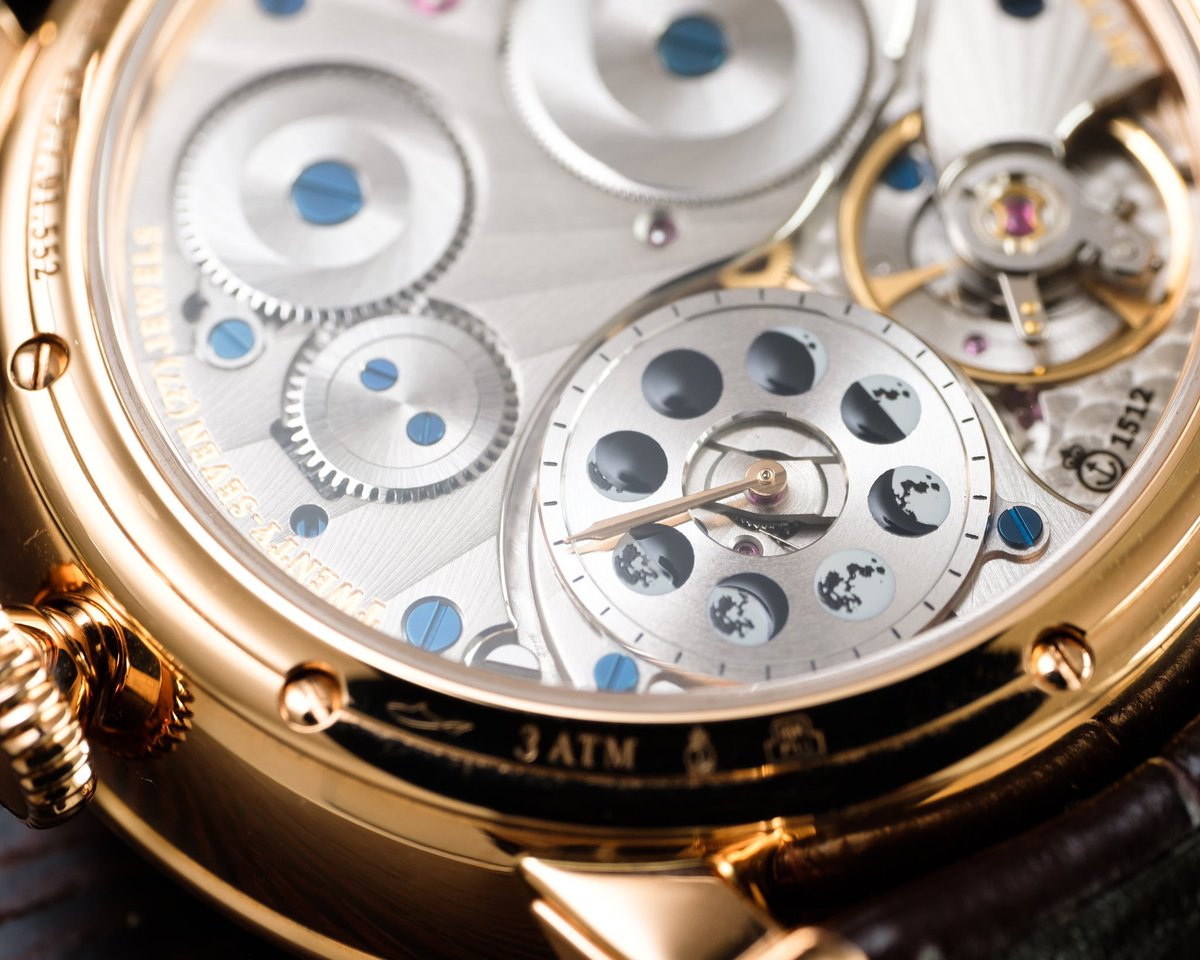 Behind the Perpetual Moon's magnificently oversized lunar display is an ingenious, integrated moon phase movement with a pointer-style display of the phases of the moon to reference when setting it.