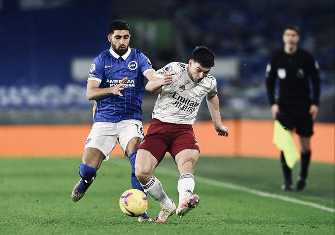Kieran Tierney challenges for possession at the Amex