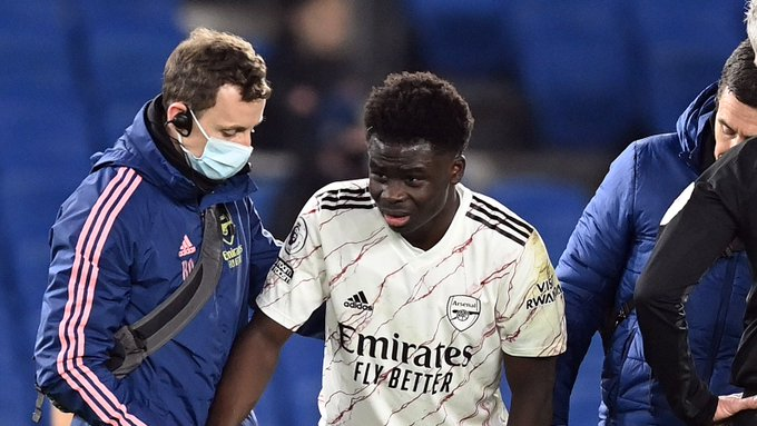 Bukayo Saka is helped off the pitch
