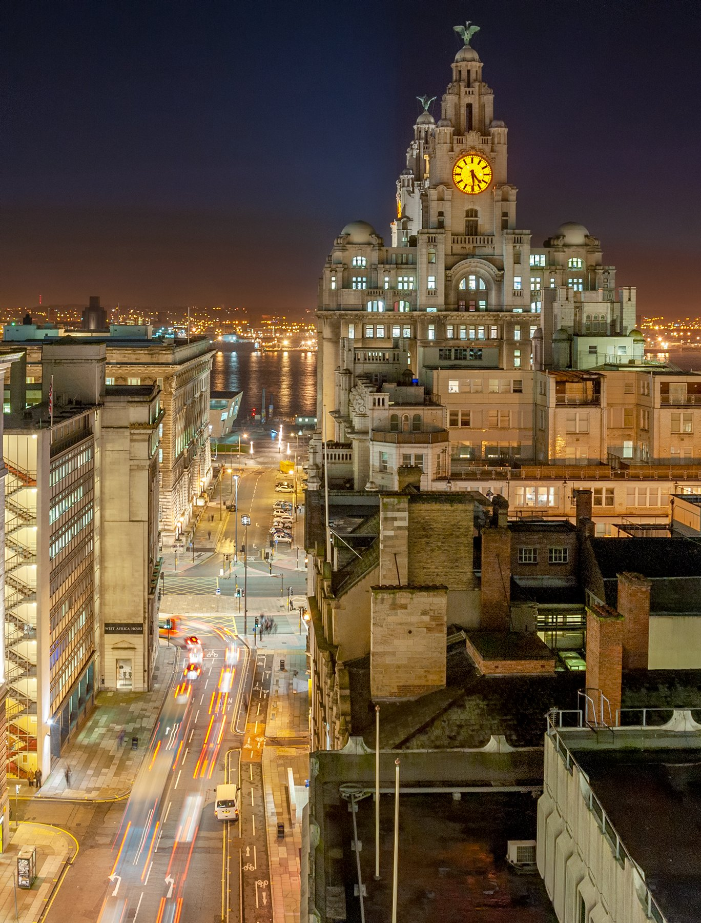 View down Water Street, Liverpool towards the River Mersey and Royal Liver Building.
