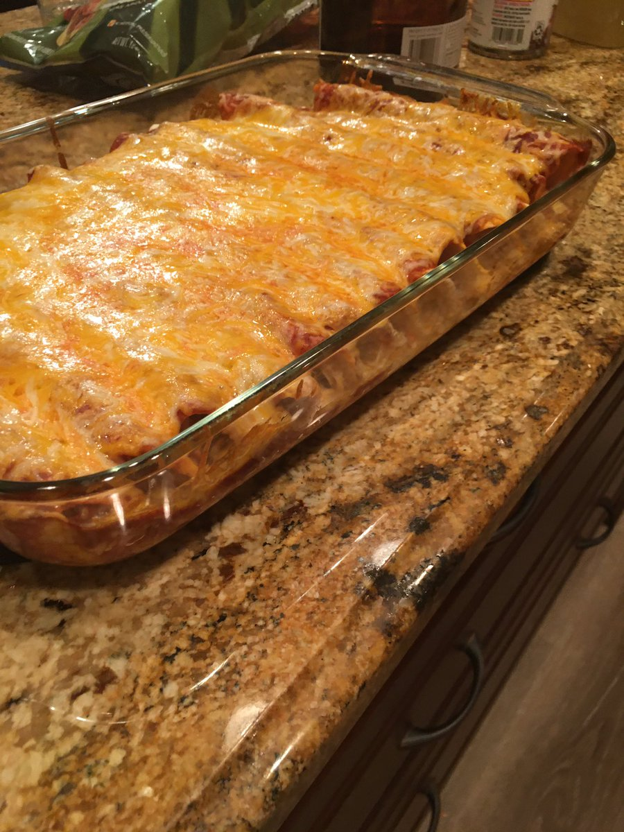 Made some homemade chicken enchiladas, Spanish rice, and beans #Food