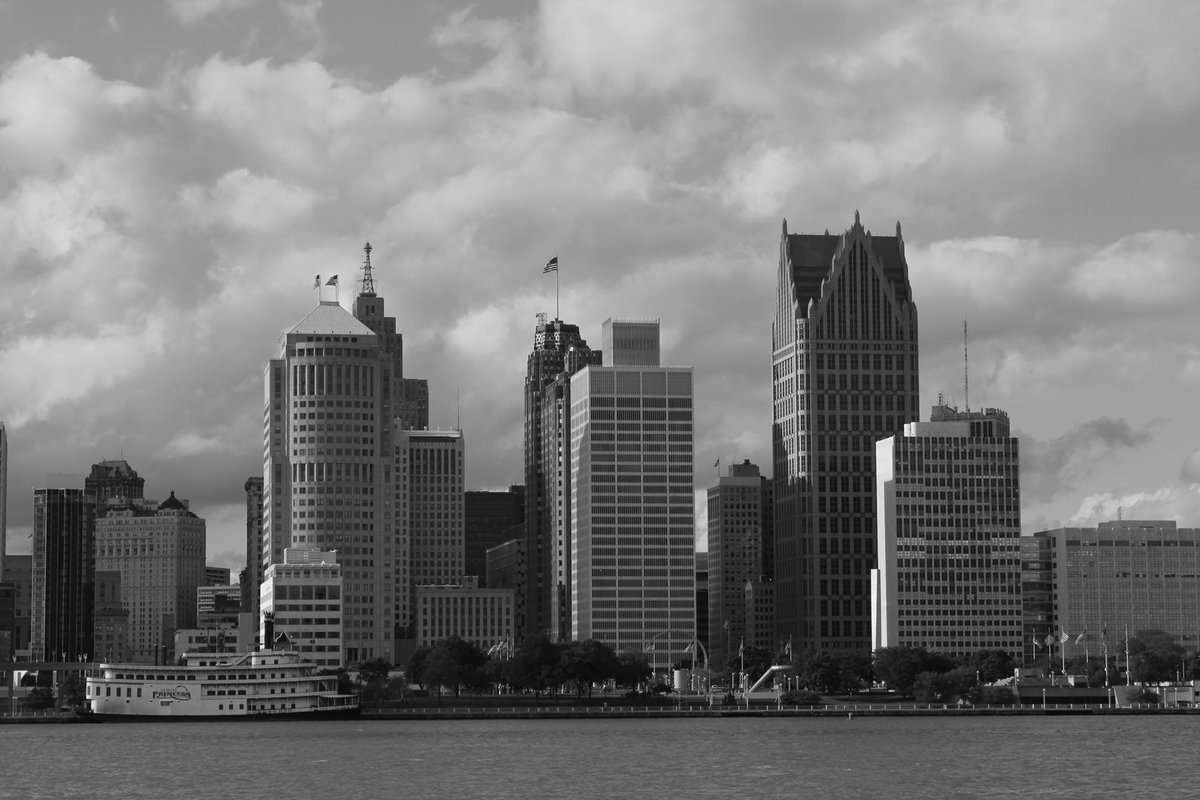 Detroit cityscape. The steamboat you see on the bottom left is the Detroit Princess, a steamboat that was made in Louisiana and brought up to Detroit, Michigan.  #detroit #michigan #cityscape #photography #blackandwhite
