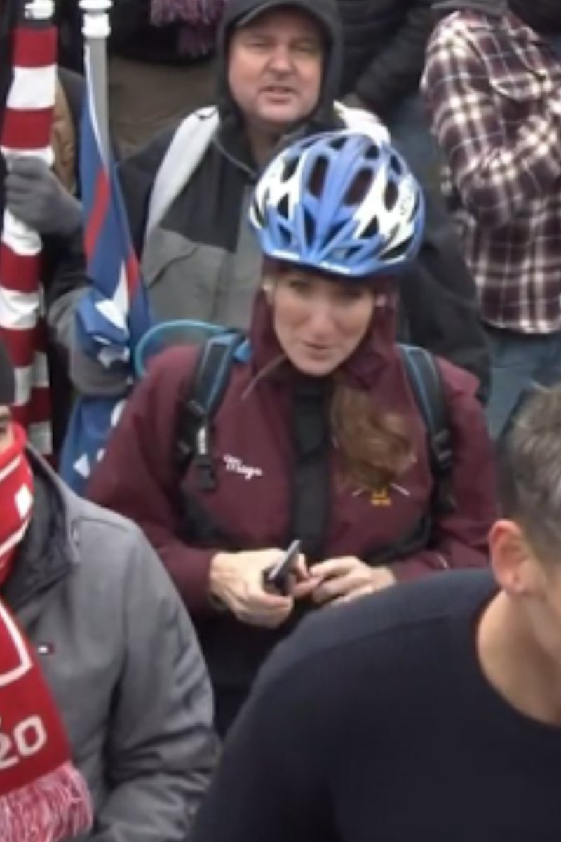 @ProjectLincoln @MaggieMulvaney Is this her in the burgundy coat, blue bike hat. Coat says Mags a nickname for Maggie??