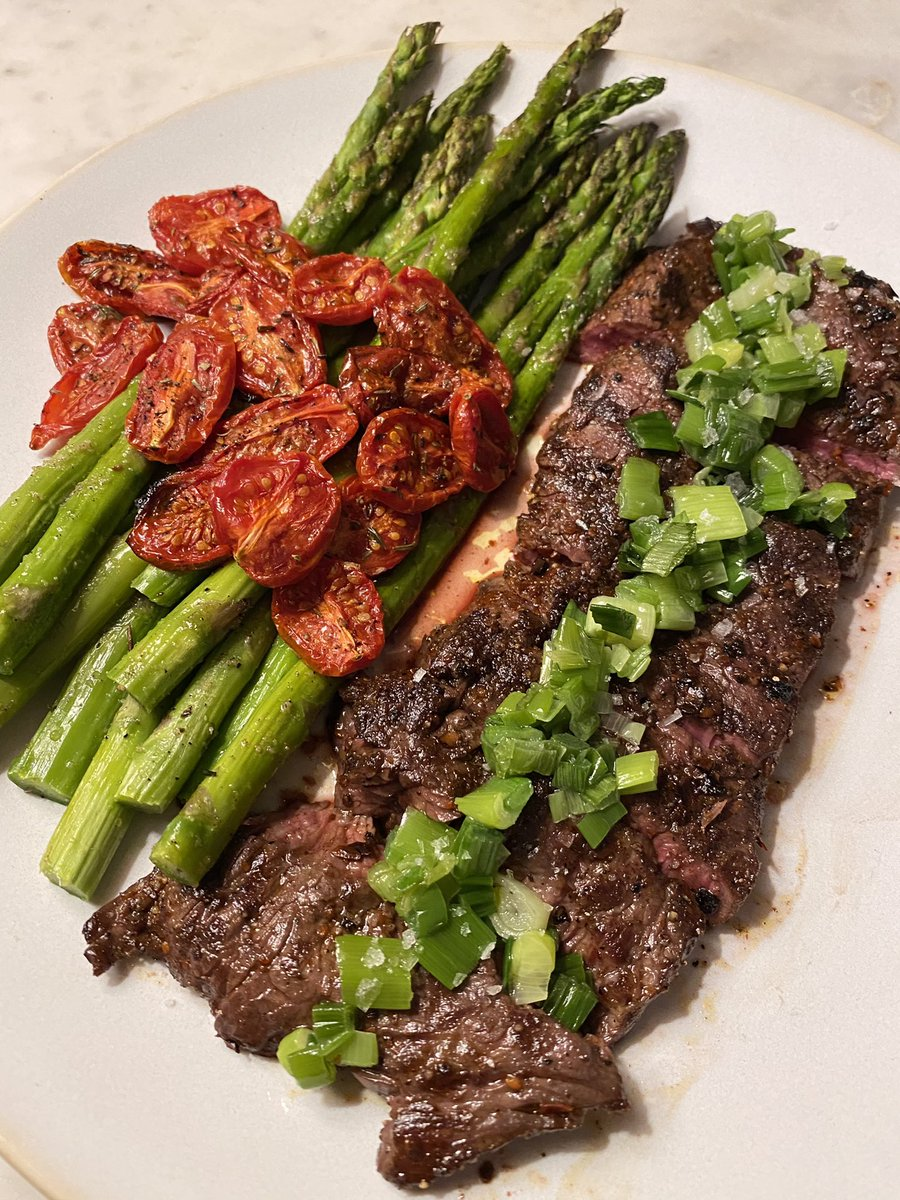 Aleppo pepper hanger steak topped with scallion oil + garlic roasted asparagus and tomatoes #ChezSebastian #NYC #Food #Cooking #ChelseaNYC