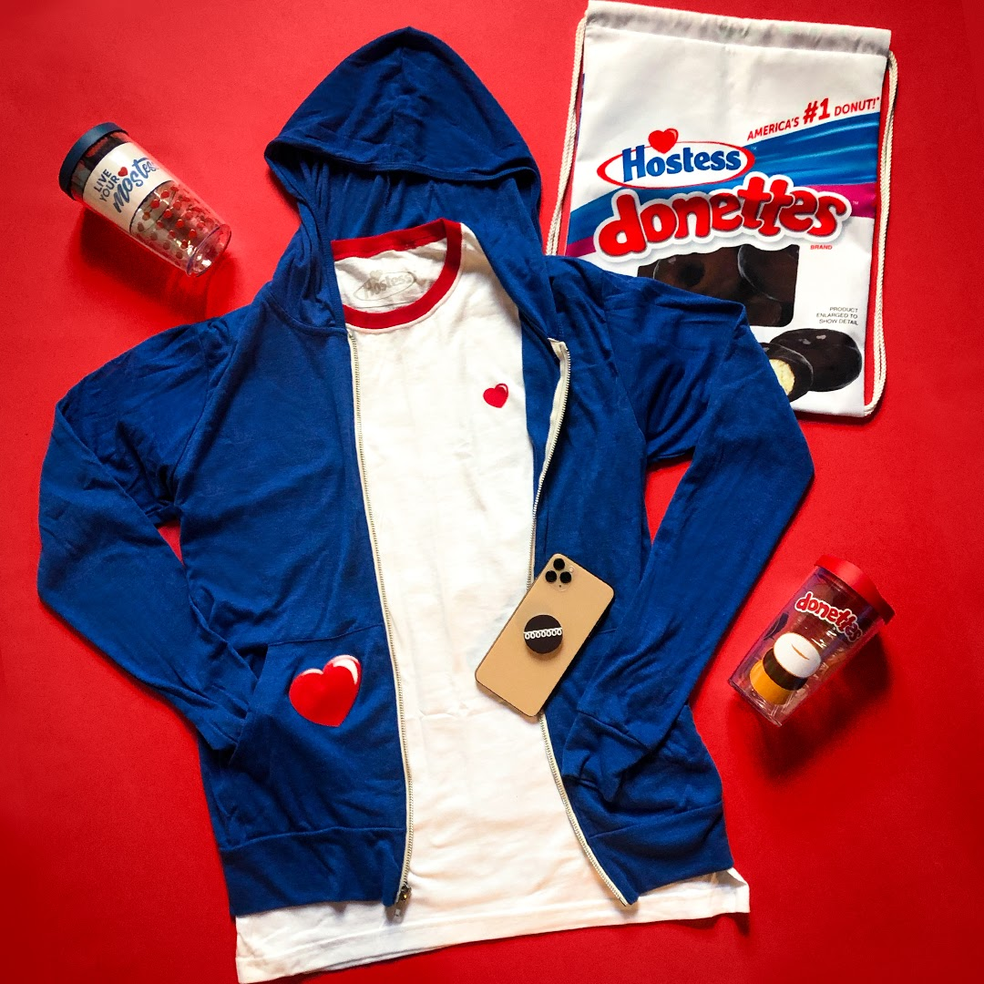 #OOTD. ❤️ Head to our eStore at link in bio to shop this season's sweetest merch!  ... #HostessSnacks #eStore #Merch #Merchandies #Donettes #Swag #CupCakes #PopSocket #Shop #Shopping #OnlineShop