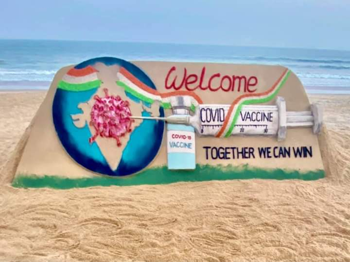 """New hope & new beginning. World's largest #vaccination drive will start from today in India . I welcome #CovidVaccine SandArt at Puri beach with message """"Together we can win """". Jai jagannath 🙏"""