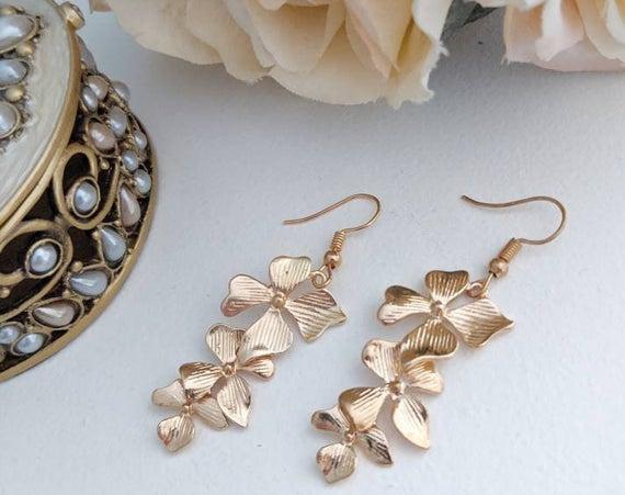Long gold orchid earrings,  via @EtsySocial #torontostyle #shoplocal #Longgoldearrings #orchidearrings