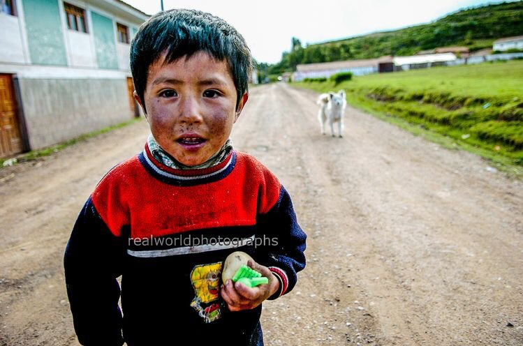 A dirty-faced boy and his dog in Chinchero, Peru, South America. #peru #southamerica #travel #boy #dog #chinchero #nikon #poverty #malmo #sweden #skane #videoproduction #photojournalism  #realworldphotographs #photography